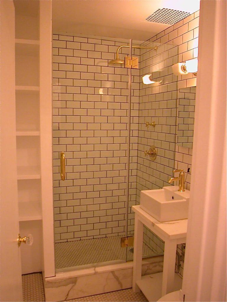 polished brass shower door system
